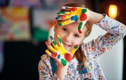 Funny Child Girl Draws Laughing Shows Hands Dirty With Paint Stock Image