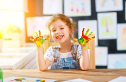 Funny Child Girl Draws Laughing Shows Hands Dirty With Paint Royalty Free Stock Photos