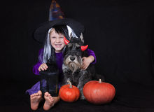 Funny child girl dressed witch costume with pumpkin. Halloween holidays concept. Royalty Free Stock Photos