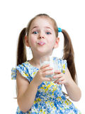 Funny child girl drinking yogurt or kefir. Over white Royalty Free Stock Photography