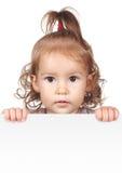Funny child girl hold white banner Stock Photo