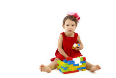 Funny child girl playing with construction set over white Stock Image