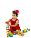 Funny child girl playing with construction set over white Royalty Free Stock Image