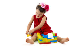 Funny child girl playing with construction set over white Royalty Free Stock Photo