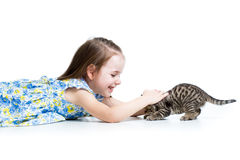 Funny child girl playing with kitten Royalty Free Stock Photos