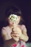 Funny child girl showing a marshmallow cake Stock Photo
