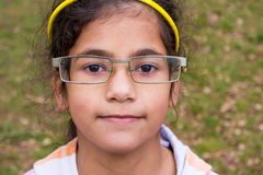 Funny child girl wear too big glasses royalty free stock image