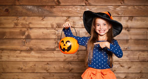 Funny child girl in witch costume in halloween Stock Image