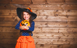 Funny child girl in witch costume in halloween Stock Images
