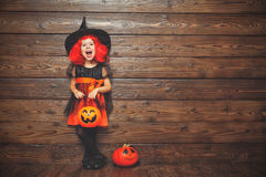 Funny child girl in witch costume in halloween Stock Photo