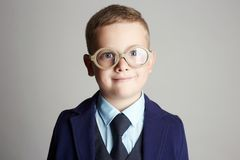Funny child in glasses. little boy in suit Royalty Free Stock Photo