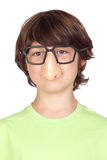 Funny child with glasses and nose joke Stock Images