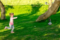 Funny child in glasses playing in a summer park. stock images
