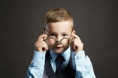 Funny child in glasses and siut.genius Kids. Idea stock image