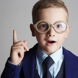 Funny child in glasses and siut Stock Photo