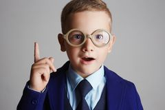 Funny child in glasses and siut Stock Photos