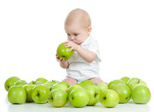 Funny child with green apples Royalty Free Stock Images
