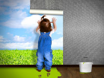 Funny child hanging wallpaper, doing repairs. Stock Images