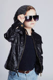 Funny child in hat.fashionable little boy in sunglasses.stylish kid in leather Stock Photos