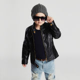 Funny child in hat.fashionable little boy in sunglasses.stylish kid in leather Stock Photo