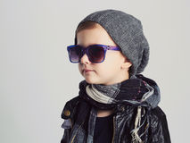 Funny child in hat and sunglasses.fashionable little boy Royalty Free Stock Images