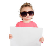 Funny child. Holding blank paper, isolated on white background Stock Photo