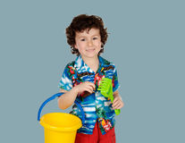 Funny child in holidays with a bucket and shovel Royalty Free Stock Photos
