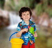 Funny child in holidays with a bucket and shovel Stock Image