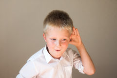Funny child listening Stock Images