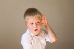 Funny child listening Stock Photo