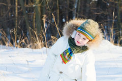 Funny child looking curious in a winter park Royalty Free Stock Photography
