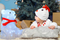 Funny child looks at a bear. Christmas. New Year Royalty Free Stock Photos
