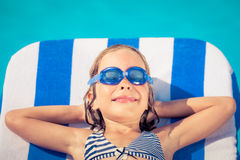 Funny child lying on beach bed Royalty Free Stock Images