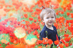 Funny child  outdoor at poppy field Royalty Free Stock Photo