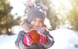 Funny child outdoors in winter day Royalty Free Stock Images