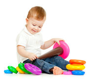 Funny child playing with color pyramidion. Funny child with color toys Royalty Free Stock Images