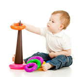 Funny child playing with color pyramidion. Funny child with color toys Stock Images