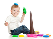 Funny child playing with color toy. Funny child playing with color pyramidion Royalty Free Stock Images