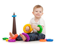 Funny child playing with color toy. Funny child playing with color pyramidion Royalty Free Stock Photos