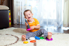 Funny child playing with color toy royalty free stock photo