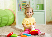 Funny child playing with color toy indoor. Funny child playing with toy indoor Royalty Free Stock Photos