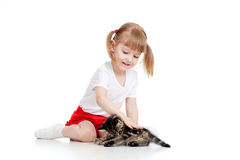 Funny child playing with cute kitten Royalty Free Stock Image