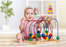 Funny child playing with educational toy indoor Royalty Free Stock Images