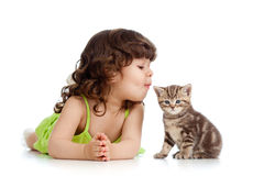 Funny child playing and kissing kitten Royalty Free Stock Photos