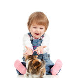 Funny child playing with kitten Royalty Free Stock Photos