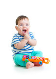 Funny child playing with musical toys Stock Photography