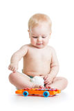 Funny child playing with musical toys Royalty Free Stock Photos