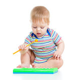 Funny child playing with musical toys on white backgr Stock Photography