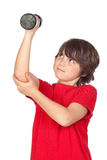Funny child playing sports with weights Royalty Free Stock Photo