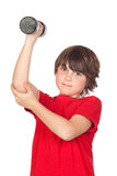 Funny child playing sports with weights Stock Photos